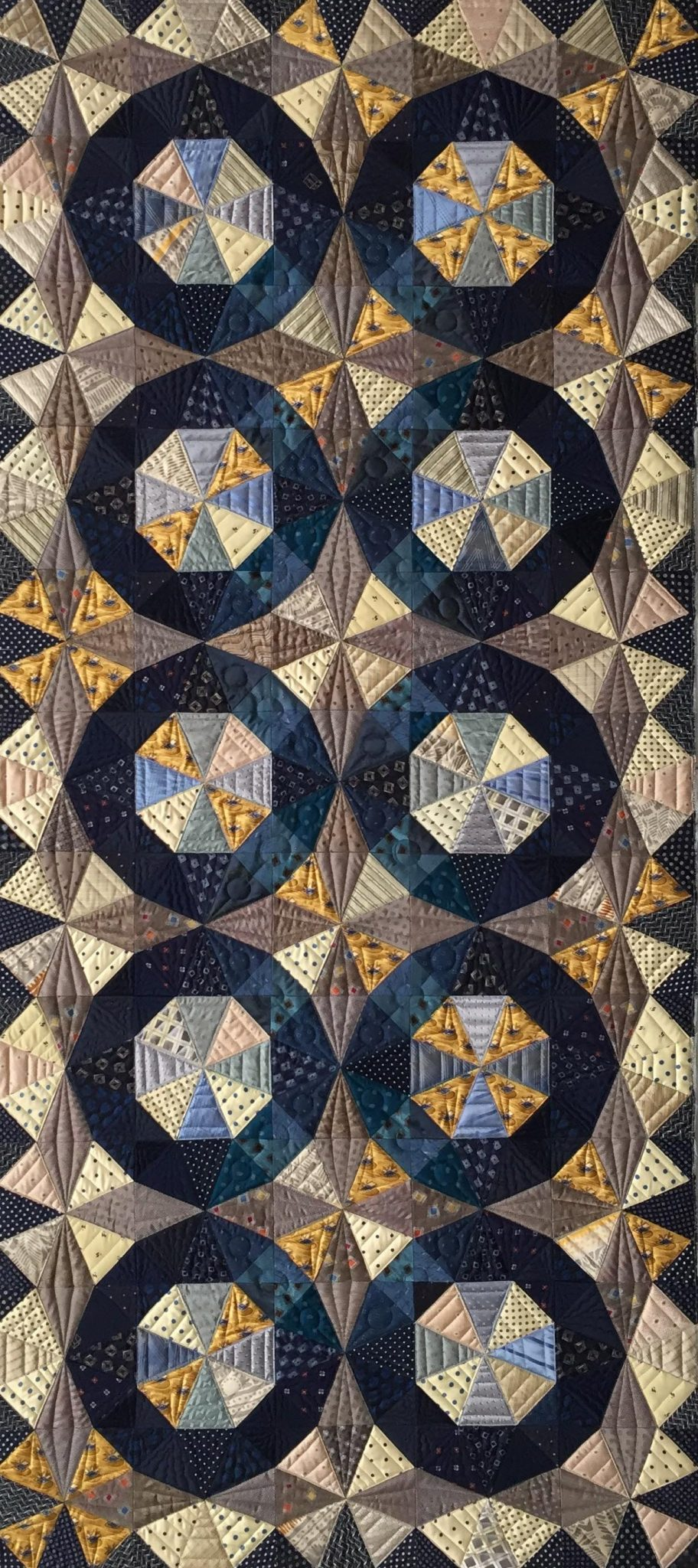 Blue Wheels made by Julia McLeod, quilted by Sue Fox
